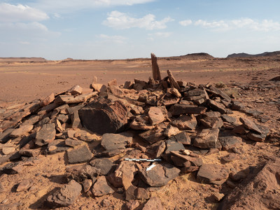 This burial site in a badlands area of AlUla in north-west Saudi Arabia is currently rare for Neolithic-Chalcolithic Arabia in being built above-ground and meant to be visually prominent.