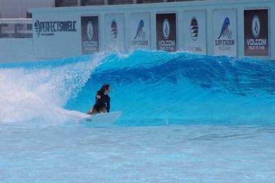 Amuro Tsuzuki backside bottom turn on a peeling left in preparation for surfing's Olympic debut.